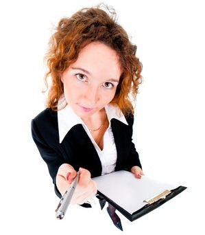 Businesswoman holds out a pen