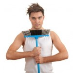 serious young man in casual shirt with sweeping brush