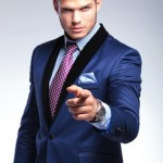 young business man pointing at you